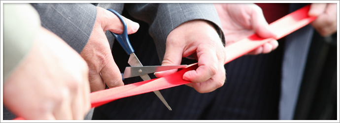 person cutting ribbon